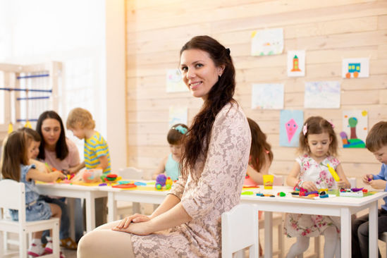 woman sitting in front of a group of children